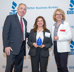 Frances Rahaim receiving a reward as a finalist at the BBB